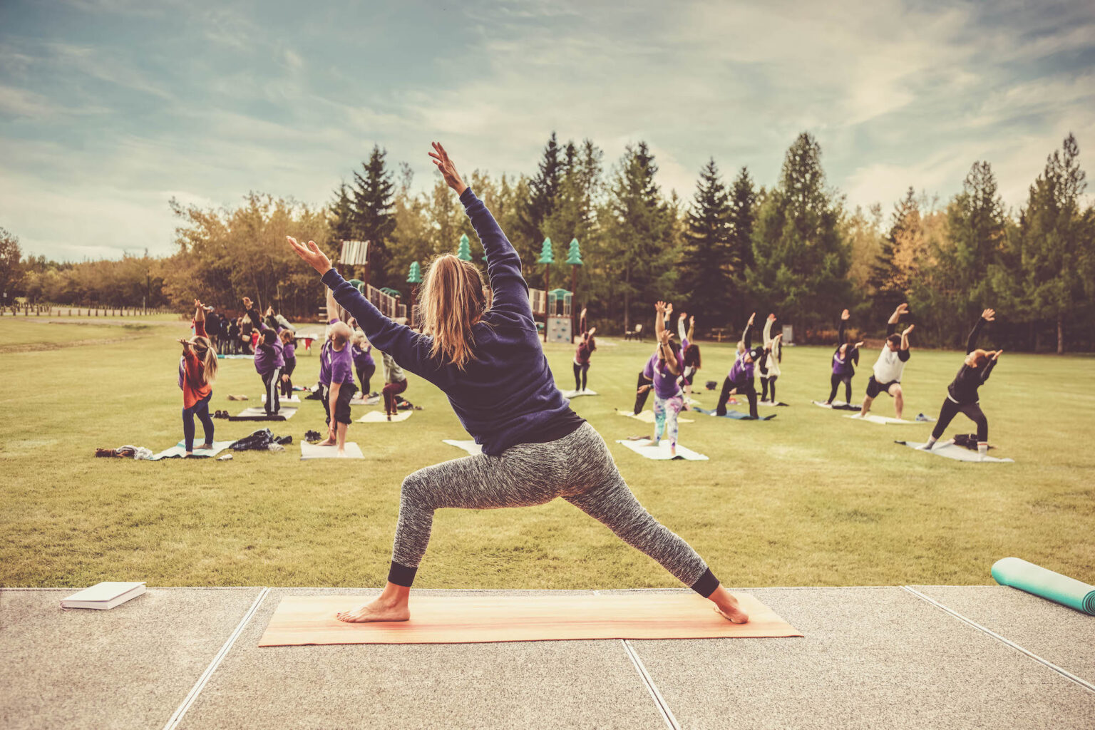Yoga classes outdoors. Group of adults attending yoga classes in the park. Healthy lifestyle. Being healthy in body and mind